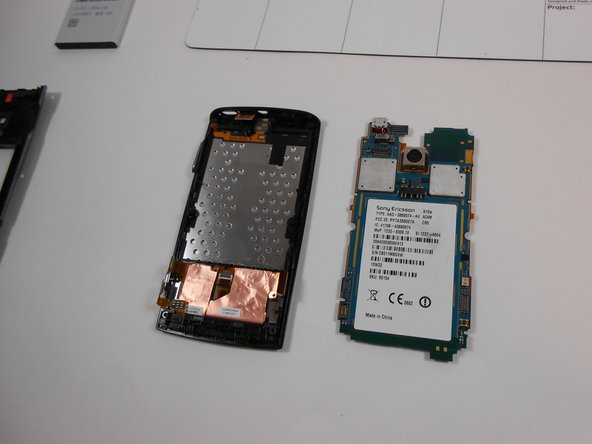 Logic board should be removed from the phone. Put it off to the side.