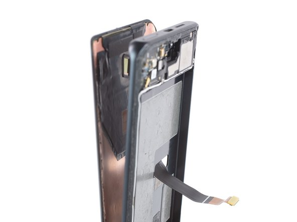 Thread the display flex cable through the gap in the midframe and remove the display.