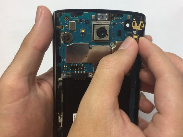 Using the flat end of a plastic spudger or a plastic opening tool, wedge it under the front cameras' motherboard connection and disconnect it.
