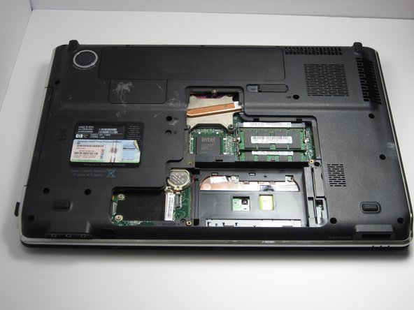 Lift the panel to remove it from the device.