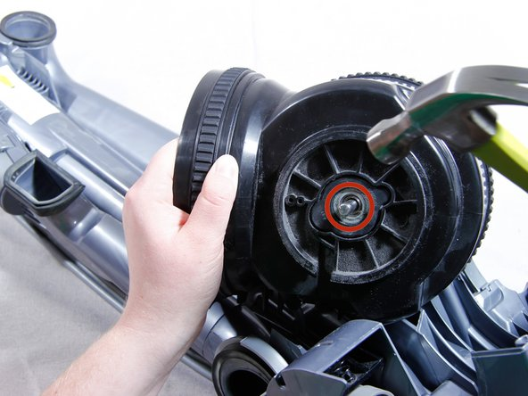 Release the motor assembly from its housing by strongly hitting the brush clutch axle with a hammer.