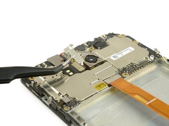 Remove the metal plate covering the rear camera flex cable.