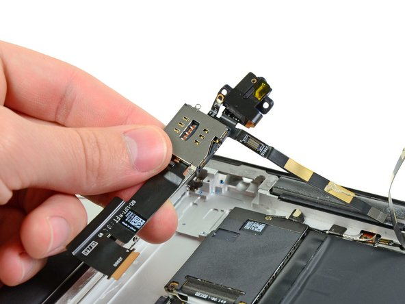 Remove the headphone jack/SIM slot from the iPad 2.