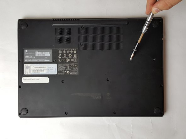 Use a PH1 screw head to remove the 16, 6mm screws from the bottom case housing of the laptop.