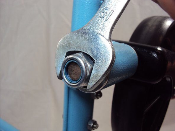 Remove the caster wheels by unscrewing the bolt under the cap with a 19 mm wrench.