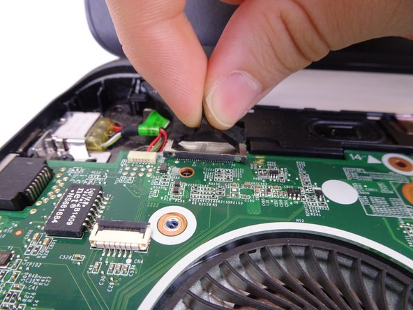 Remove the display connection wire. Lift the connection straight up from the motherboard.