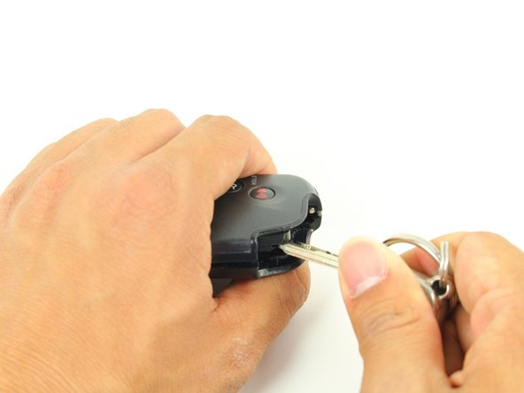 Image 2/3: You may feel like you're breaking the keyfob, but be firm while twisting.