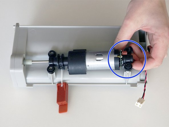 Remove the black stabilizer attached to the motor's circuit plug end.