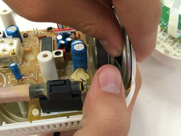 Locate the speaker and desolder the contact points.