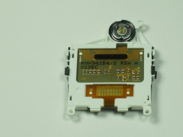 Gently pry it out the speaker located in the screen housing with a small screwdriver or similar tool.
