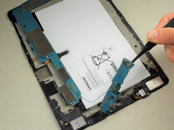 Keep the two portions of the motherboard together. If the connecting cable is damaged, it could further ruin the condition of the board.