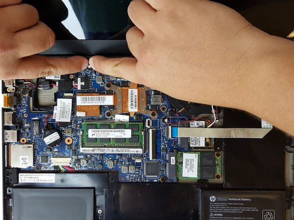Carefully unplug the connection to the motherboard using your finger or the nylon spudger.