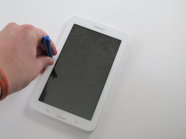 Using a plastic opening tool, wedge in the seam between the screen and the case.