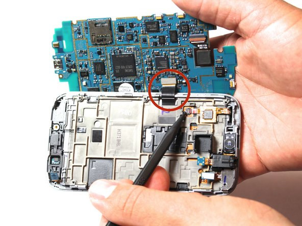 Pull the motherboard back and out to the left. Make sure the motherboard is faced straight up, as shown in the photo.