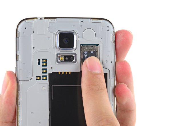 Using a fingertip, pull the microSD card straight down out of its slot.