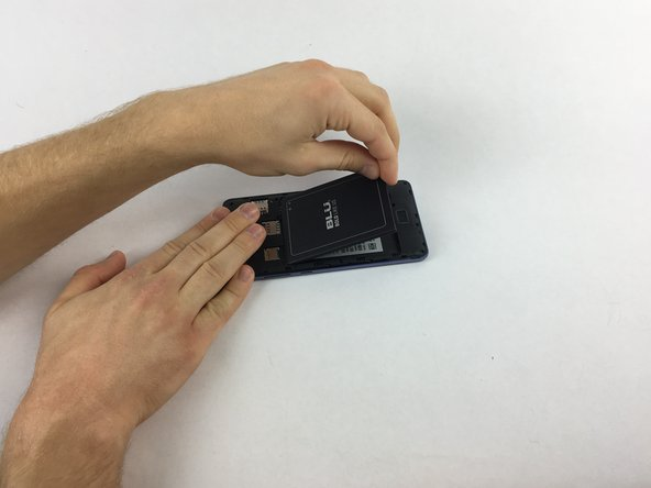 Remove the battery by lifting the lower edge of the battery up first.