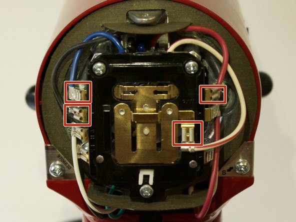 Using pliers or tweezers, remove the connectors of the four wires attached to the circuit board.