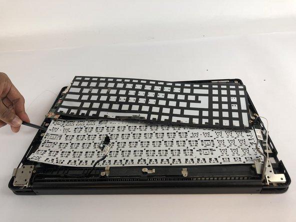 Slide the black Spudger underneath the  keyboard to loosen it.