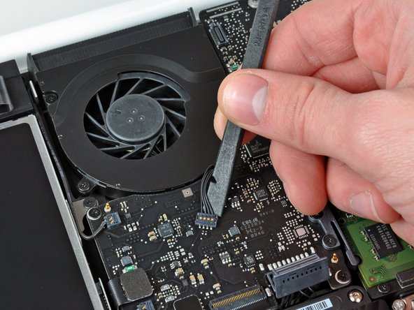 Use a spudger to pry the fan connector straight up and out of its socket on the logic board.