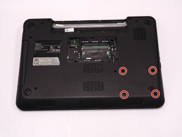 Close cover and turn laptop over. Locate and remove the four hard drive screws.