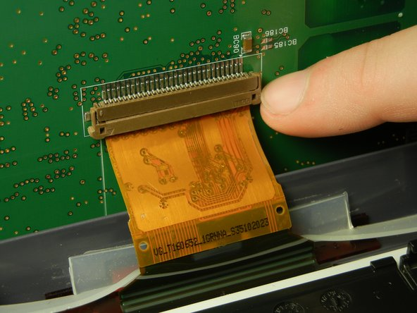 Image 1/1: Detach the circuit board from the brown ribbon.