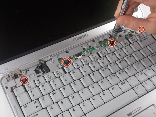 Remove the four 3mm Phillips #1 screws that secure the keyboard to the computer.