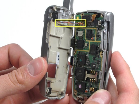 Image 1/1: Be careful not to rip out the  wire (highlighted in yellow)  when separating the back housing.