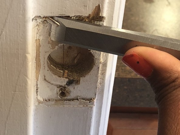 An easy way to do this is to tap the end of the chisel with a hammer.