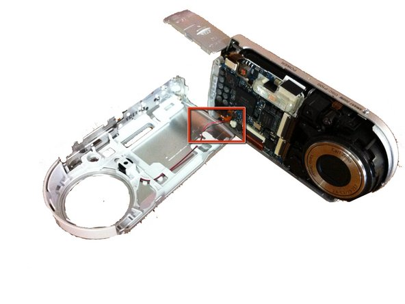 Image 2/2: CAUTION: Be careful not to break the wire connecting the front casing and the camera.