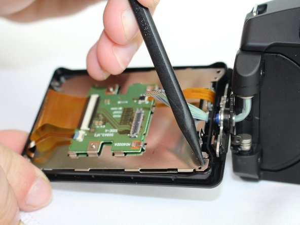 Use a spudger to lift the LCD screen out of its placement and remove it from the casing.