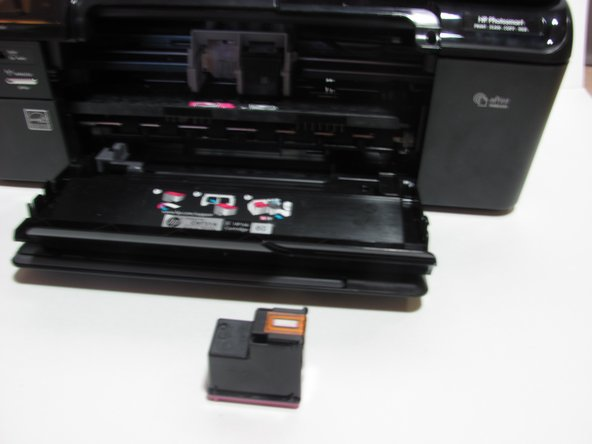 Remember the orientation of the old cartridge. The new cartridge will be placed in the slot with the same orientation.
