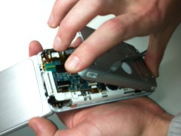 Image 2/2: Detach the back plate from the rest of the device.