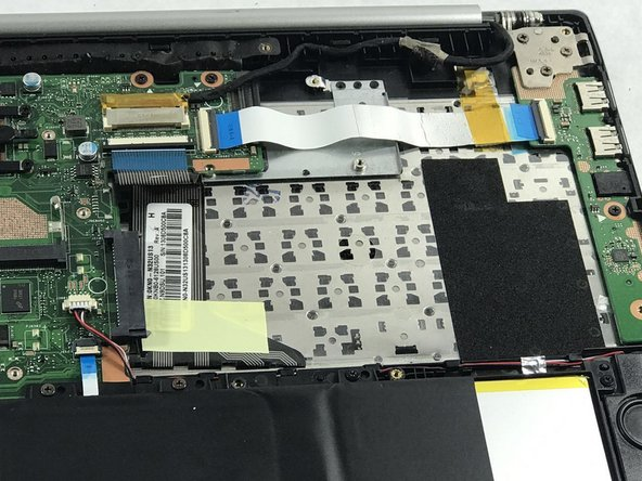 Remove the SSD (Solid State Drive) assembly from the upper case.
