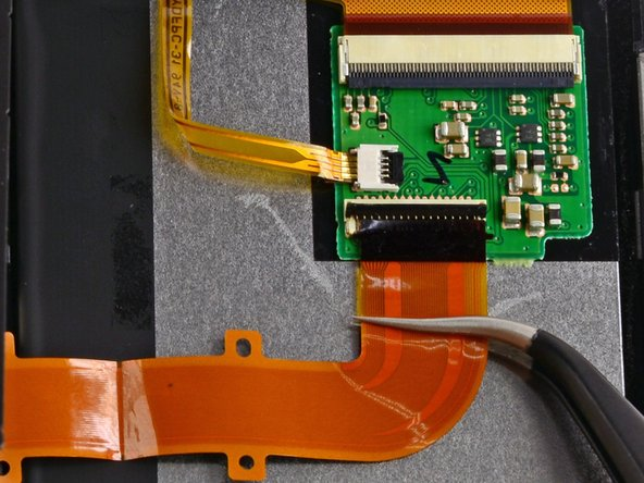 Gently pull the ribbon cable out with tweezers.