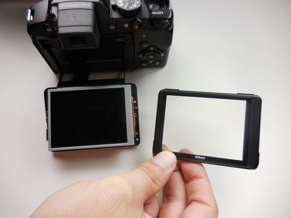 Use a plastic opening tool to trace around the screen to pop the front and back section apart.