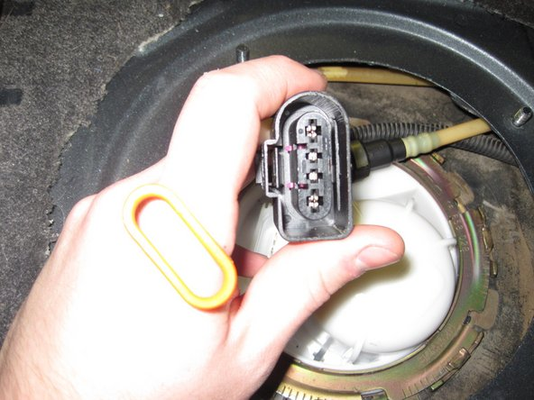 Disconnect the connector on the fuel filter assembly.