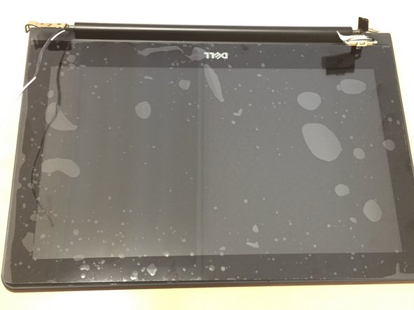 Image 1/2: Carefully set the main chromebook chassis on top of the new LCD assembly.