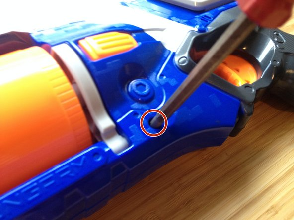 Unscrew all of the 12 screws on the Nerf gun.
