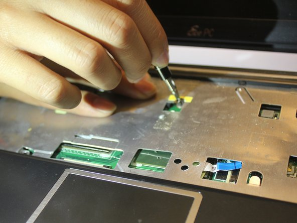 Unscrew the 8 screws on the back chassis and the 7 screws on the keyboard area