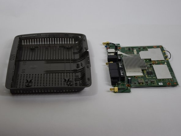 Image 3/3: Put the motherboard over a (preferably white) surface.