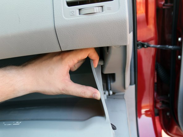 Push the two side walls of the glovebox towards the center to free the stopper peg on each side.