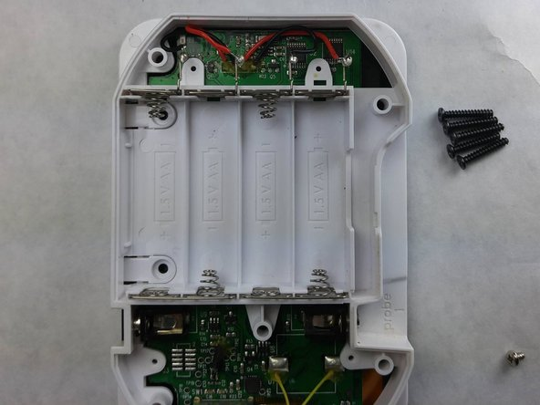 Gently and slowly pull the back cover off of the iGrill, exposing the power cables to the motherboard.