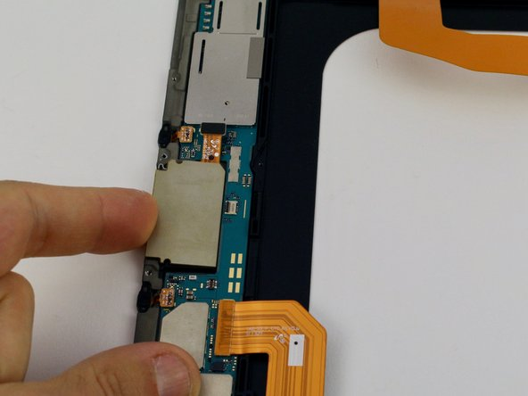 Next pry the Micro SD card tray up from the midframe on the left with your finger.