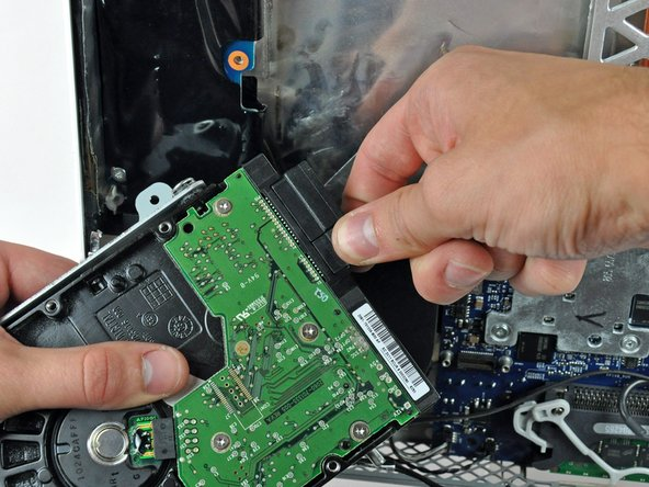 Image 1/1: Disconnect the SATA data cable by pulling its connector away from the hard drive.