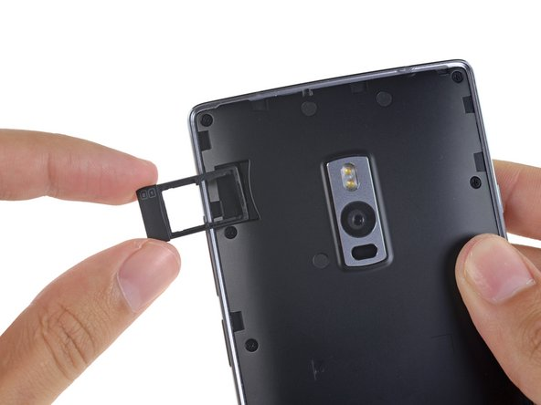 Image 3/3: The easily-removable rear case means increased repairability—though we suspect the ease of replacement has more to do with OnePlus' [http://www.droid-life.com/2015/07/27/oneplus-2-styleswap-covers-here-are-your-5-options/|StyleSwap covers|new_window=true].