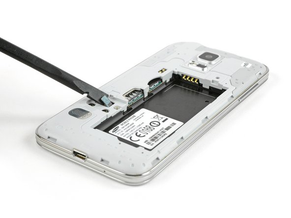 Image 2/3: For reassembly, insert the home button cable connector through the open slot in the display assembly.