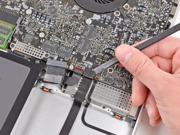 Use the flat end of a spudger to pry the hard drive connector up and out of its socket on the logic board.