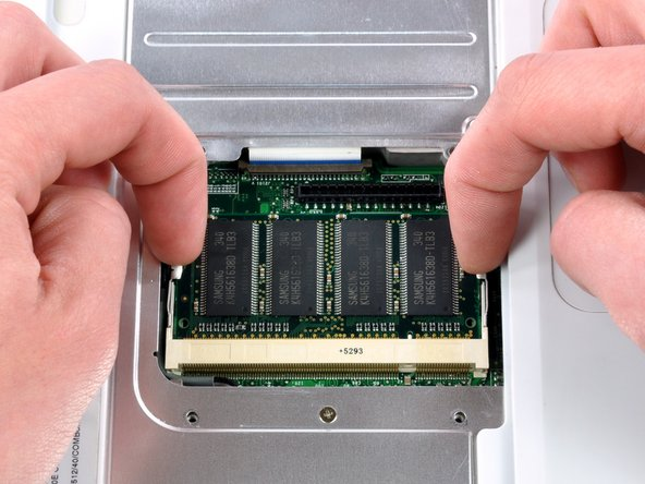 Image 1/2: Pull the chip directly out from its connectors.