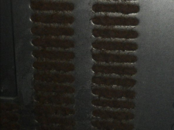 Image 1/2: On the picture yoou see the bad clogged air louvers on the backside of my fridge. This is the filth from only THREE YEARS ! The air cant flow unhindered, thats very bad for the fridge.