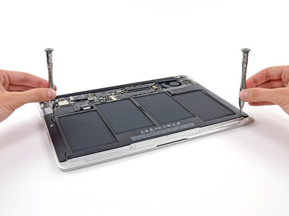 Image 1/3: ''iFixit fun fact:'' All iFixit guide makers must be ambidextrous enough to simultaneously use two screwdrivers.